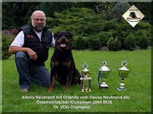 Orlando vom hause Neurand with trophies and breeder